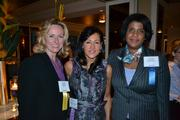 From left, Heather Cox of Capital One, Laura Lee Williams of Laura Lee Designs and Guylaine Saint Juste of Capital One.