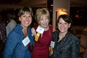 From left, Kathy Albarado, president and CEO of Helios HR, Linda Mathes of the American Red Cross in the National Capital Region and Ellen Goitia of KPMG LLP.