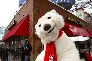 The Coca-Cola Co.'s polar bear was there for the grand opening.