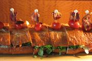 The Party Sub, a double-smoked BLT with bibb lettuce and Roma tomatoes.