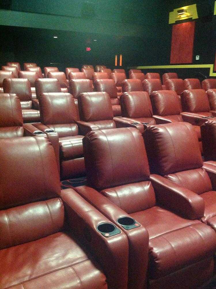 AMC has been making improvements like replacing standard chairs with cushy recliners.