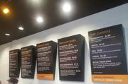 The menu board promises some set pizzas plus allows customers to build their own. The second restaurant along Olentangy River Road uses digital menu boards.