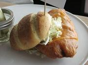 The wharf, a beer-battered tilapia fish sandwich, available in the Machine Room.