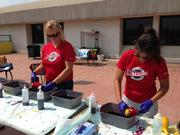Patty Strain, left, and Gianna Nucci prepare tie-die T-shirts for veterans at the Washington, D.C. Veterans Affairs Medical Center.