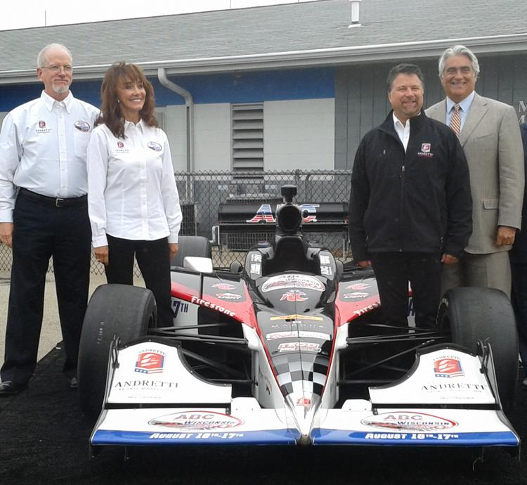 Diane Hendricks took the Milwakee Mile IndyCar race title sponsor role for her company ABC Supply. Joining her in this photo are (left to right) Kevin Healy of Andretti Sports Marketing, Michael Andretti of Andretti Sports and Mark Miles, CEO of IndyCar's parent company.