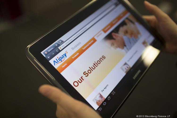 Alibaba's  Alipay.com website displayed on a tablet. Alibaba has gained NYSE and Nasdaq approval for its partnership structure.