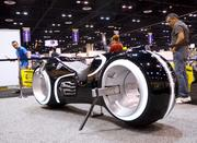 A TRON cycle built by Parker Brothers Concepts gets some well-deserved attention. Parker Brothers creates custom bike and auto designs for the film industry and collectors.