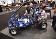 Guests check out an ATV from the Trail Master company on the exhibitor floor.