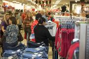Shoppers check out the merchandise at the new Belk store in Morganton.