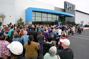A crowd waits outside for the Salisbury Belk to open.