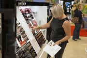 A woman browses in the cosmetics department at Belk's new Morganton store.