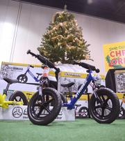 A holiday display by the Strider company — makers of no-pedal balance bikes for kids — is a reminder to both watch out and try not to cry.