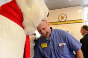 Coca-Cola's Mr. Bear makes friends with Dave Rickell, executive vice president of operations for Waffle House