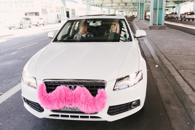 Lyft vehicles are adorned with pink moustaches.
