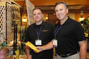 Ed Brunot, left, chairman of the American Logistics Association and JD Fenessy sponsor and chair emeritus of the American Logistics Association, sample Hawaii-made products at the American Logistics Food Show at the Hawaii Prince Hotel.
