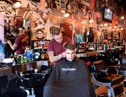 Floyd's 99 Barber Shop, best place for men's haircuts. Shown: Manager John Carmona and customer Cam Martin