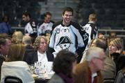 Admirals player Joshua Shalla talks with guests.