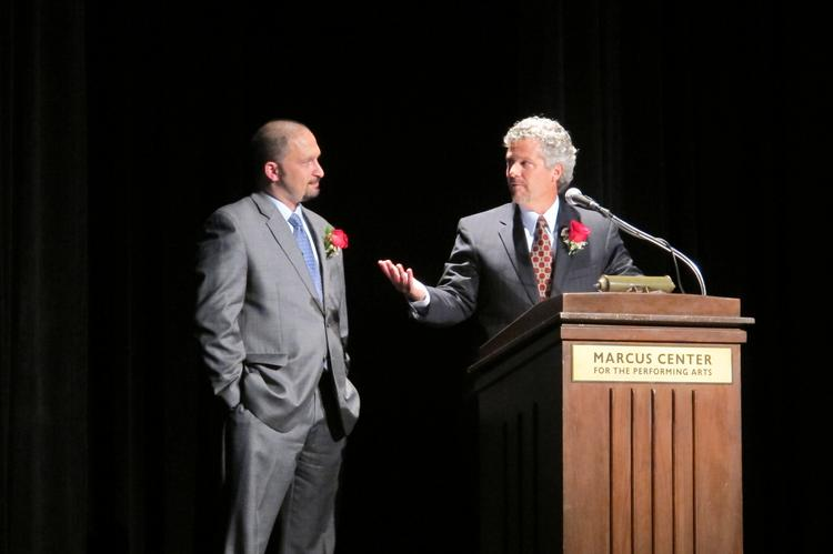 NAI MLG Commercial's Stephen Provancher (right), CARW immediate past chairman, and association president Jim Villa during Wednesday night's event in Vogel Hall at the Marcus Center for the Performing Arts