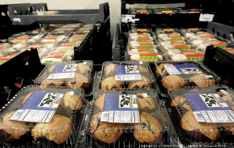 Schwartz Brothers Bakery makes baked goods for Trader Joe's stores, including these cases of blueberry muffins and mini carrot cakes waiting to be shipped out. Such cult favorite items have many in Jacksonville waiting with bated breath for one of the stores to open locally.