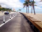 Restored beach along A1A in Fort Lauderdale, showing a metal retaining wall.