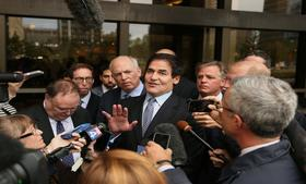 Mark Cuban, billionaire owner of the NBA Dallas Mavericks basketball team, leaves federal court after an acquittal in Dallas.