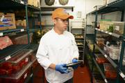 Dave & Buster's kitchen manager, Alvaro Duarte uses the Proxomo app throughout the day at the company's Central Expressway location.