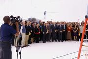 About 100 politicians and business leaders gathered for a group shot in front of the HondaJet at a new customer service facility at the Piedmont Triad International Airport.