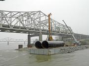 Piers to support the downtown bridge already have begun to rise from the Ohio.