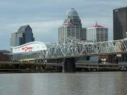 This view from the river shows the Clark Memorial Bridge with the downtown Louisville skyline and the KFC! Yum Center in the background.