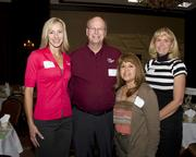 Paula Brusig, Keith Howes, Laura Monteil and Carrie Yuhre of Western Health Advantage pose at the Business Journal's Best Places to Work awards Tuesday. Western Health came in second place in the medium companies category.