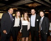 Sebastian Salas, Jacqueline Stafford, Roxanne Quane, Nick Cavanaugh and Mark Thompson, all of Aerotek, pose at the Business Journal's Best Places to Work awards Tuesday. Aerotek was an honoree in the small companies category.