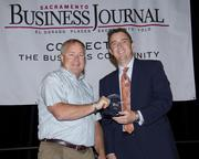 Owen Taylor, owner of Owen-Dunn Insurance Services, poses with Sacramento Business Journal Publisher Terry Hillman after accepting an award for the company. Owen-Dunn won third place in the small companies category at the Business Journal's Best Places to Work awards Tuesday.