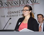Jackie Lau of Paradies accepts an award. The company won the medium companies category at the Business Journal's Best Places to Work awards Tuesday.