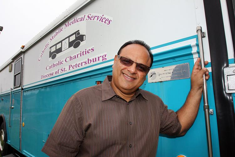 Carlos Irizarry, registered nurse and pastor, with Wholesome Community Ministries, with the free health mobile clinic.