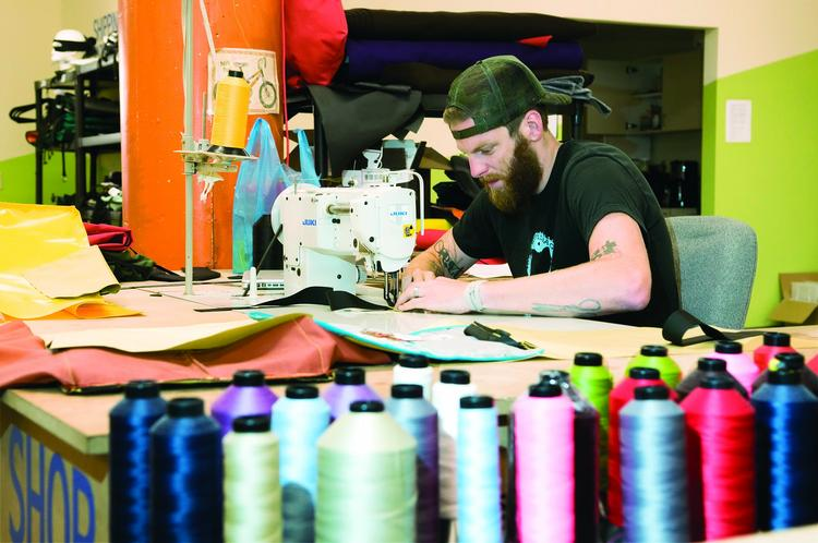 Owner Daniel McKewen learned how to sew to launch the business and still makes the bags by hand at the company's downtown headquarters.
