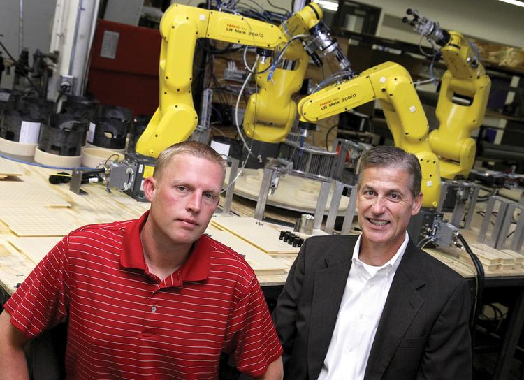 Vice-President of Automation Dustin Hills and Director of Sales and Marketing Larry Gronau of Q Corporation & Automation, LLC.