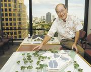 Glenn Miura, principal of CDS International, shows a model of the Nanakuli Public Library and how plans for greenery and landscaping will add to its sense of place. It is being designed to   capture natural light and air and the surrounding views of Nanakuli Valley, the Waianae Mountains and the ocean.