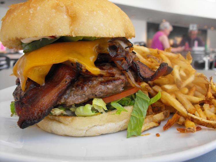 The half-pound burger features local Lucky Dog Ranch grass-fed beef and comes with all the fixings of your choice.