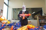 Videology CEO Scott Ferber, who has a box of masks in his Locust Point office, is shown here wearing a unicorn mask.