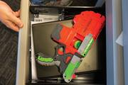 Videology employees stash Nerf guns and ammo in desk drawers and open spaces at the ready.