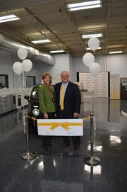 Karen Kaufman and Walter Payne pose during a ceremony Thursday at the Gastonia company's new location.