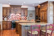 Yorkshire: The kitchen features pine cabinets, top-of-the-line appliances, two center islands and a breakfast room.