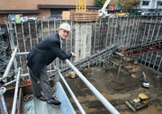Bart Eberwein of Hoffman Construction poses above the construction site of park Avenue West in 2008, a year before TMT Development halted construction for economic reasons.
