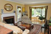 Webster Woods: The living room has a gas-burning fireplace, and also has bay windows.