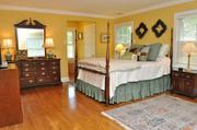 Webster Woods: On the second floor, the master suite is accompanied by four other bedrooms and two full bathrooms.