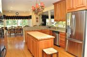 Webster Woods: The kitchen features custom cabinetry, granite countertops and stainless steel appliances.