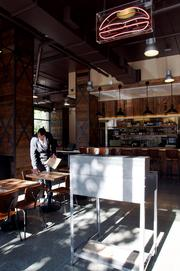The new Umami Burger on Third and King Streets is styled after an old train depot that used to occupy the space.