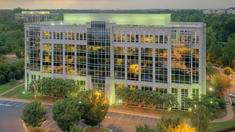 Three office buildings at the Coliseum Centre office park have been listed for sale with CBRE.