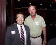 Sacramento Regional Builders Exchange President Peter Tateishi and Michael Martin of Systems Tech Inc. pose at the Sacramento Regional Builders Exchange.