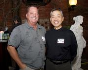 Mike Vernon of Alliance Roofing Company and Matthew Shighara of Lionakis pose at the Sacramento Regional Builders Exchange mixer.